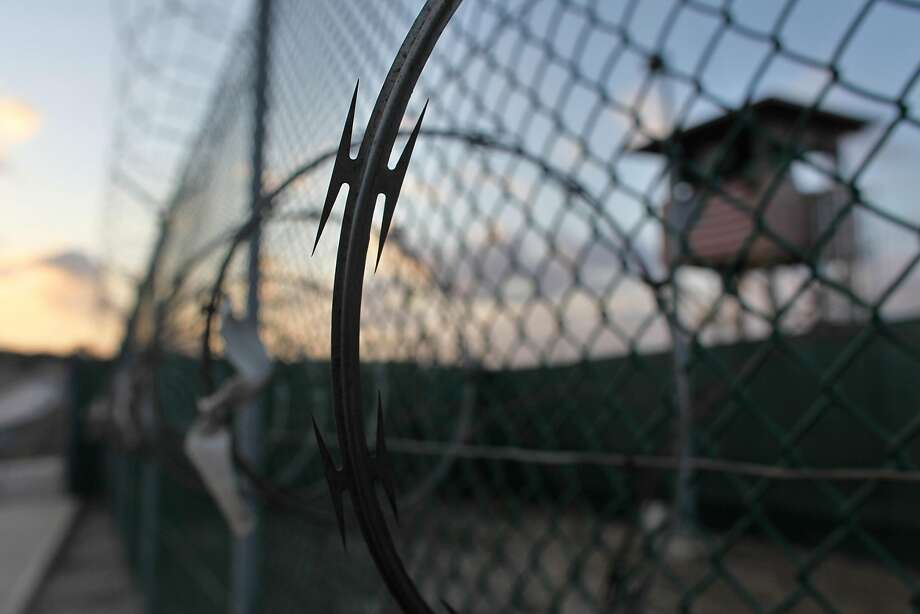FILE - In this May 13, 2009 file photo reviewed by the U.S. military, the sun rises over the Guantanamo detention facility at dawn, at the Guantanamo Bay U.S. Naval Base, Cuba.  In the last comprehensive review of prisoners held at Guantanamo Bay, the U.S. government decided nearly 50 were �too dangerous to transfer but not feasible for prosecution,� leaving them in an open-ended legal limbo. Now in 2016, it seems many may not be so dangerous after all. (AP Photo/Brennan Linsley, File) Photo: Brennan Linsley, AP