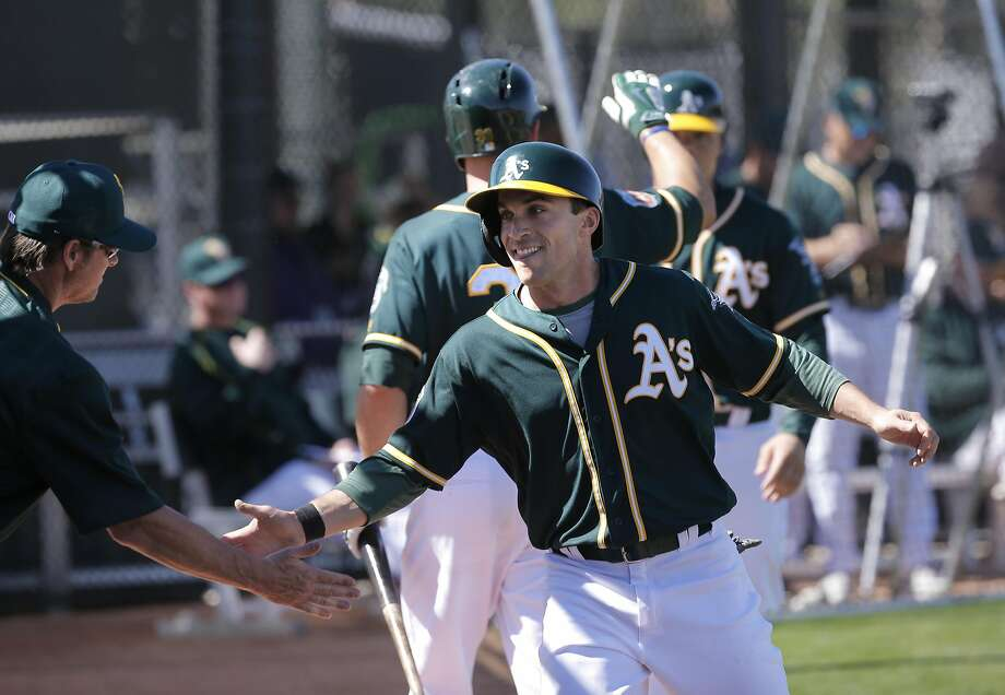 Sam Fuld, 23 scores a run on a hit by teammate Rangel Ravelo, 46 during an intra-squad game during the Oakland Athletics spring training workouts on Monday February 29, 2016, in Mesa, Arizona. Photo: Michael Macor, The Chronicle