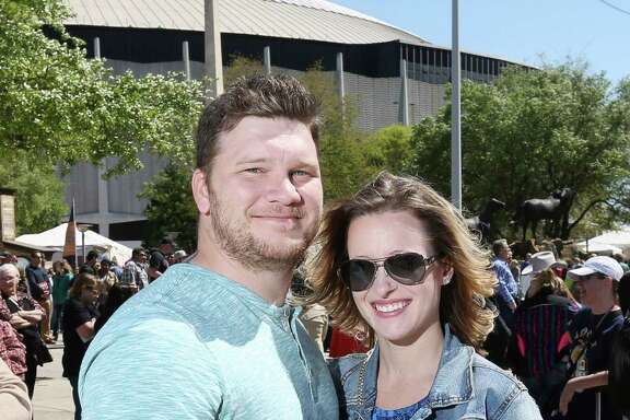 People pose for a photo before the Keith Urban concert at the Houston Livestock Show and Rodeo Sunday, March 20, 2016, in Houston.