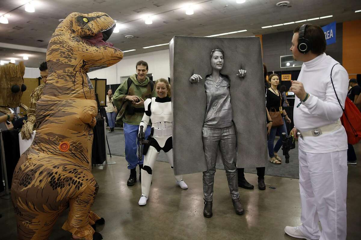 Dressed as Han Solo frozen in carbonite, Kayla Iacovino of Menlo Park draws a crowd at Silicon Valley Comic Con in San Jose, Calif., on Sunday, March 20, 2016.