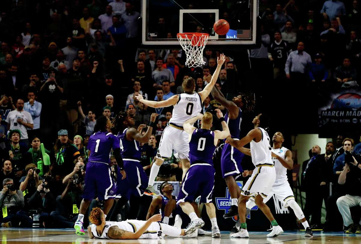 NEW YORK, NY - MARCH 20: Rex Pflueger #0 of the Notre Dame Fighting Irish tips in Stephen F. Austin Lumberjacks shot to defeat the Stephen F. Austin Lumberjacks 76 to 75 in the second half during the second round of the 2016 NCAA Men's Basketball Tournament at Barclays Center on March 20, 2016 in the Brooklyn borough of New York City.