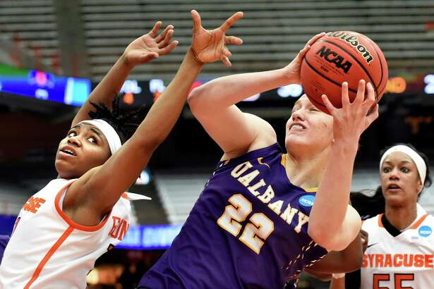 UAlbany's Heather Forster, right, wins the rebound over Syracuse's Cornelia Fondren, left, during their NCAA second round basketball game on Sunday, March 20, 2016, at the Carrier Dome in Syracuse, N.Y. (Cindy Schultz / Times Union)