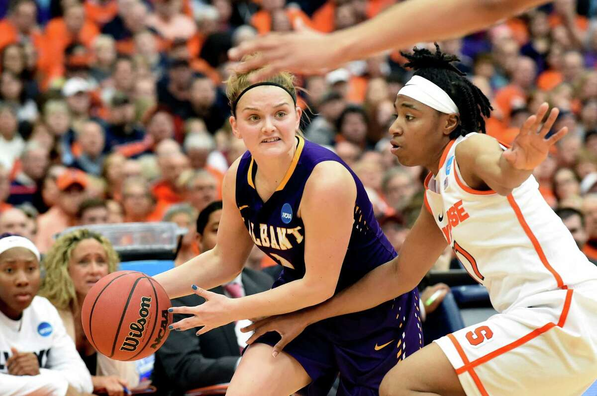 UAlbany's Erin Coughlin, left, looks to pass as Syracuse's Cornelia Fondren defends during their NCAA second round basketball game on Sunday, March 20, 2016, at the Carrier Dome in Syracuse, N.Y. (Cindy Schultz / Times Union)