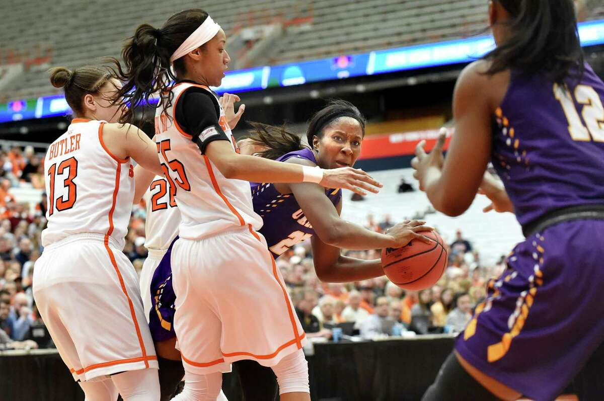 UAlbany's Shereesha Richards, center, readies to pass to Imani Tate, right, during their NCAA second round basketball game against Syracuse on Sunday, March 20, 2016, at the Carrier Dome in Syracuse, N.Y. (Cindy Schultz / Times Union)