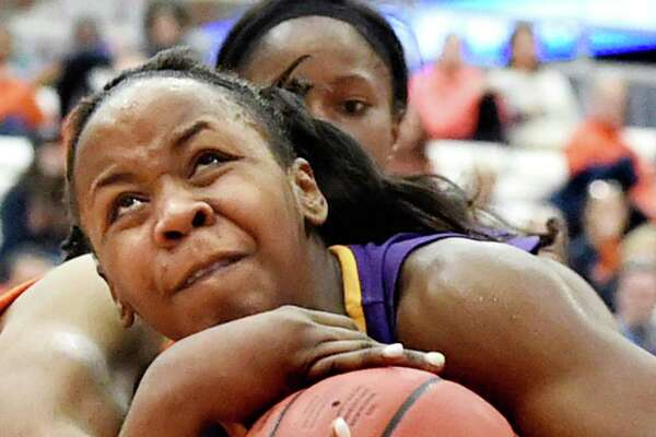 UAlbany's Imani Tate wrestles for control of the ball during their NCAA second round basketball game against Syracuse on Sunday, March 20, 2016, at the Carrier Dome in Syracuse, N.Y. (Cindy Schultz / Times Union)