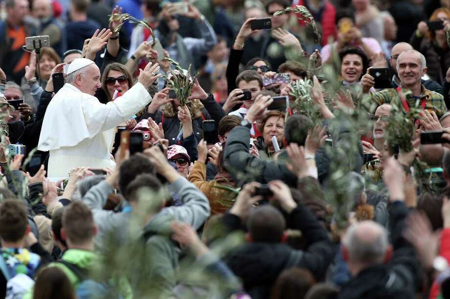 Pope Francis waves to the faithful Sunday in Vatican City, where he gave a Palm Sunday homily that compared Europe's treatment of refugees to Jesus' rejection. Photo: Franco Origlia, Stringer / 2016 Getty Images