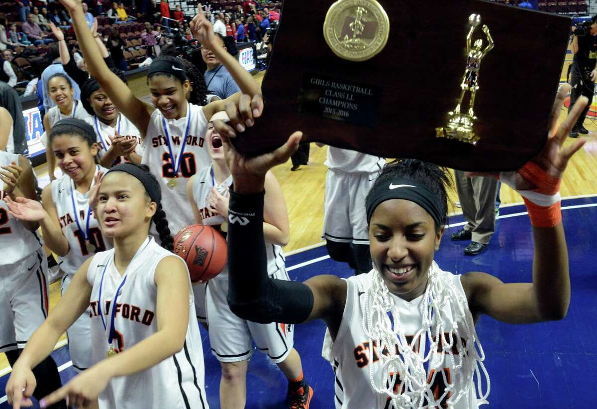 Stamford Tiana England celebrates with her teammates following their win over Greenwich in the CIAC Class LL Girls State Championship at the Mohegan Sun Arena in Uncasville, Conn. on Sunday, March 20, 2016. Stamford defeated Greenwich 50-45 to win their first CIAC State title.