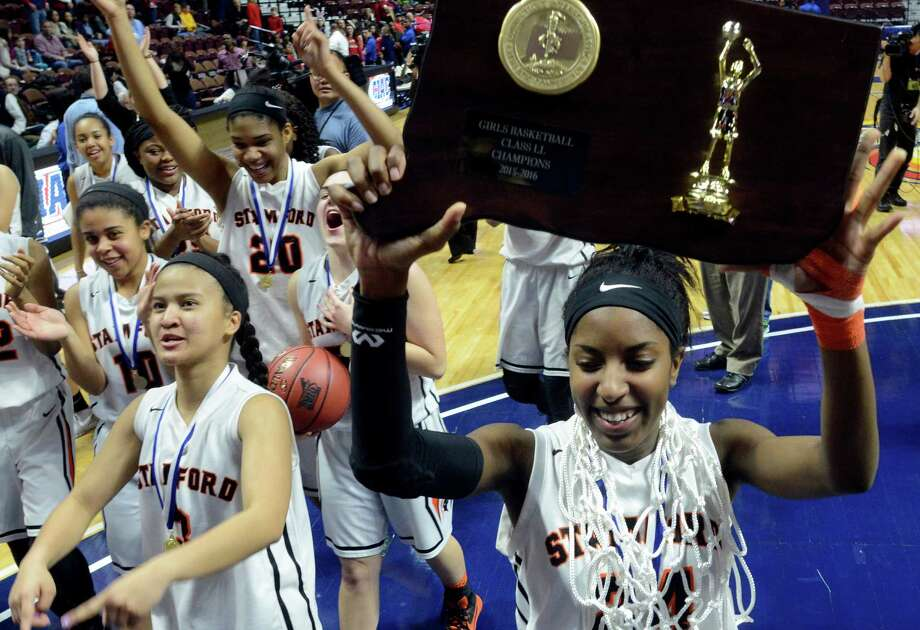 Stamford Tiana England celebrates with her teammates following their win over Greenwich in the CIAC Class LL Girls State Championship at the Mohegan Sun Arena in Uncasville, Conn. on Sunday, March 20, 2016. Stamford defeated Greenwich 50-45 to win their first CIAC State title. Photo: Matthew Brown / Hearst Connecticut Media / Stamford Advocate