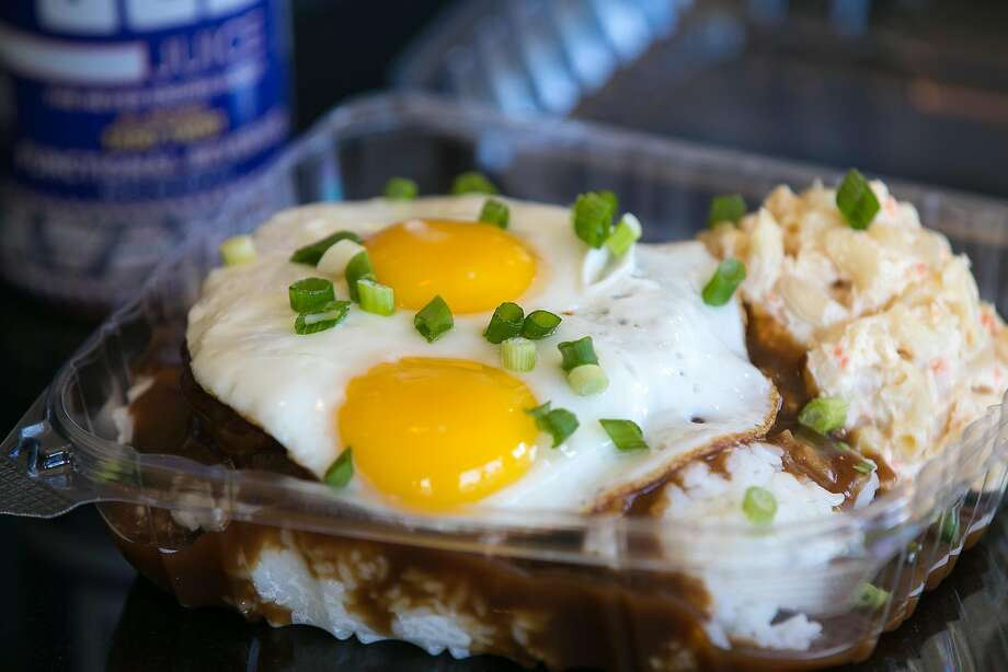 Loco moco:There are many variations, but the traditional loco moco consists of white rice, topped with a hamburger patty, a fried egg, and brown gravy.Region: Hawaii Photo: Jen Fedrizzi, Special To The Chronicle