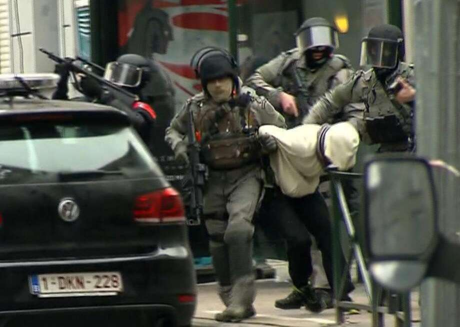 After an intense four-month manhunt across Europe and beyond, police on Friday captured Salah Abdeslam, the top suspect in last year's deadly Paris attacks, in the same Brussels neighborhood where he grew up.  Photo: TEL / VTM