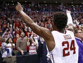 Oklahoma guard Buddy Hield (24) gestures to the Oklahoma crowd following a second-round men's college basketball game in the NCAA Tournament Sunday, March 20, 2016, in Oklahoma City. Oklahoma won 85-81. (AP Photo/Alonzo Adams)