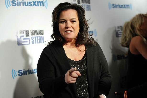 """FILE - This Jan. 31, 2014 file photo shows television personality Rosie O'Donnell attends """"Howard Stern's Birthday Bash,"""" presented by SiriusXM in New York. ABC said Thursday, July 10, 2014, that O'Donnell will return to """"The View,"""" whose couch is nearly empty with the on-air retirement of show creator Barbara Walters and impending departures of Jenny McCarthy and Sherri Shepherd.  (Photo by Evan Agostini/Invision/AP, File) ORG XMIT: NYET904"""