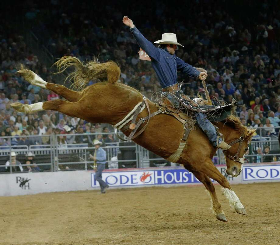 Saddle-bronc rider Cort Scheer was more than ready for Son of Sadie en route to winning Sunday's Super Shootout competition at NRG Stadium. Photo: Jon Shapley, Staff / © 2015  Houston Chronicle