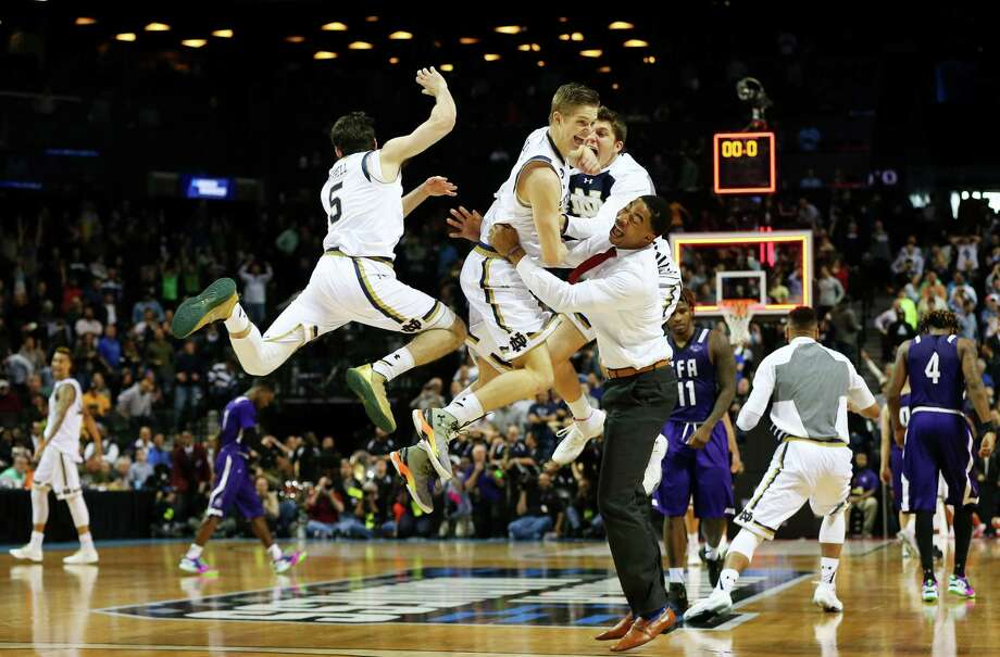 Fittingly, Rex Pflueger, center, was the highest of the Fighting Irish after Notre Dame finished off its one-point victory over Stephen F. Austin that came on Pflueger's tip-in with 1.5 seconds remaining for his only points of the game. Photo: Elsa, Staff / 2016 Getty Images