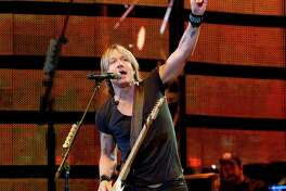 Keith Urban's sixth RodeoHouston performance - before a crowd of more than 73,000 fans at NRG Stadium - was filled with plenty of fan interaction. on the last day of the almost three-week event.