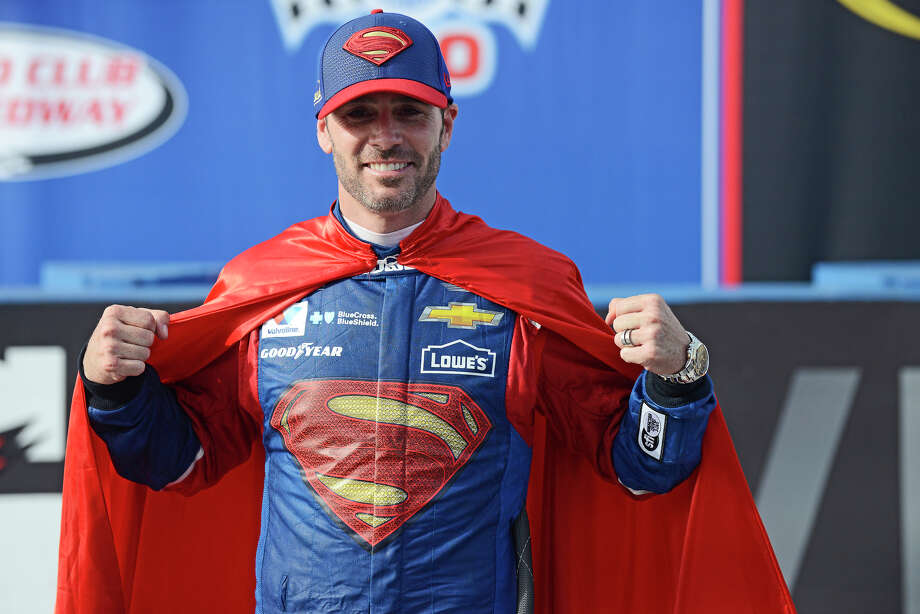 Driver Jimmie Johnson poses for a photo wearing a superman cape in after winning the Auto Club 400 NASCAR Sprint Cup Series race at Auto Club Speedway on Sunday, March, 19, 2016, in Fontana, Calif. (Jose Huerta/The Victor Valley Daily Press via AP) Photo: Jose Huerta, MBO / The Victor Valley Daily Press