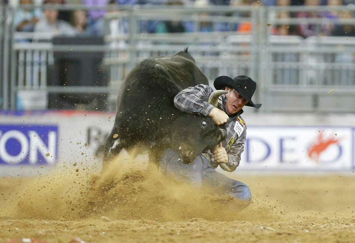 Nick Guy competes in the steer wrestling competition after also winning the day's Super Shootout: North America's Champions.