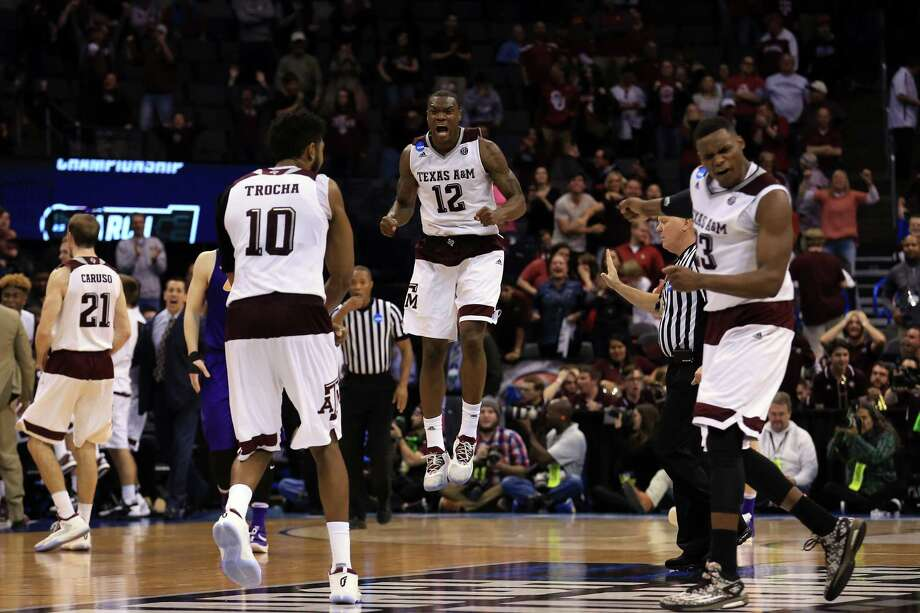 OKLAHOMA CITY, OK - MARCH 20:  Jalen Jones #12 of the Texas A&M Aggies celebrates with his teammates after they tied up the score to go to overtime against the Northern Iowa Panthers during the second round of the 2016 NCAA Men's Basketball Tournament at Chesapeake Energy Arena on March 20, 2016 in Oklahoma City, Oklahoma. Photo: Tom Pennington, Getty Images / 2016 Getty Images