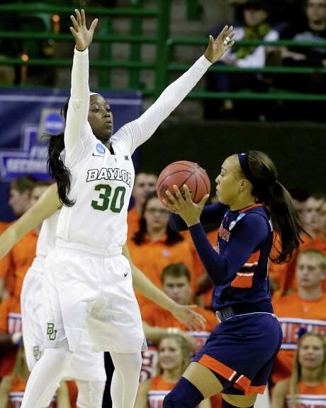 The Baylor-Auburn game was as much of a mismatch as the Lady Bears' Alexis  Jones, left, swarming the Tigers' Brandy Montgomery. Photo: LM Otero, STF