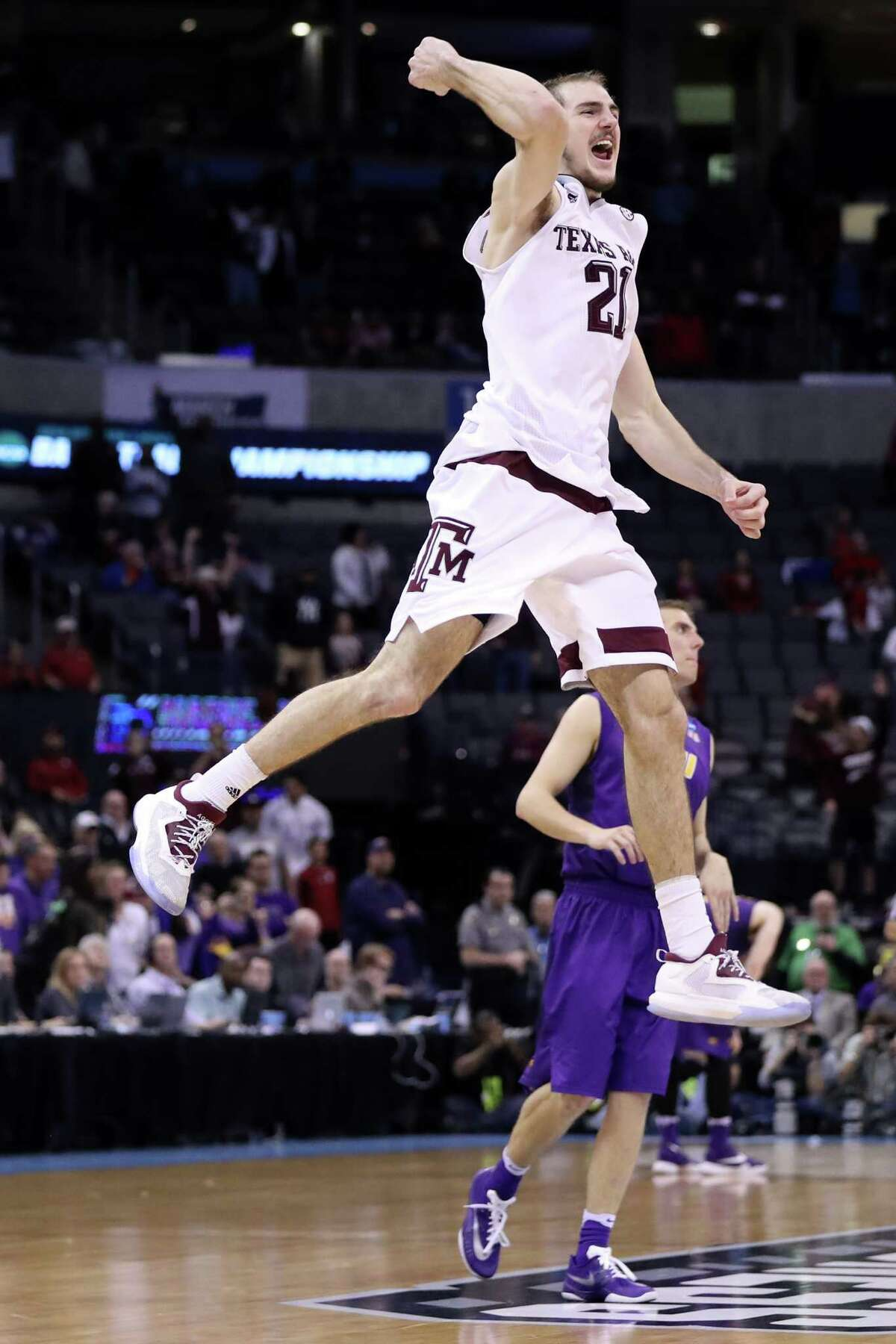 OKLAHOMA CITY, OK - MARCH 20: Alex Caruso #21 of the Texas A&M Aggies celebrates after defeating the Northern Iowa Panthers in double overtime with a score of 88 to 92 during the second round of the 2016 NCAA Men's Basketball Tournament at Chesapeake Energy Arena on March 20, 2016 in Oklahoma City, Oklahoma.