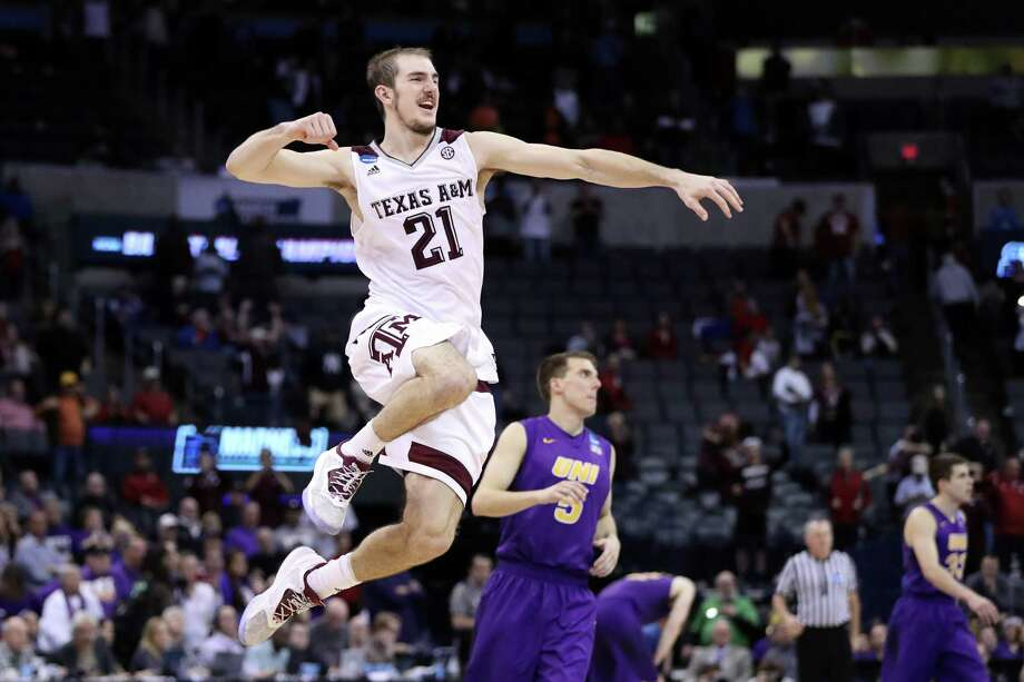 Even after playing a two-overtime game, A&M's Alex Caruso had plenty of spring in his step because of the nature of the Aggies' victory Sunday night. Photo: Ronald Martinez, Staff / 2016 Getty Images