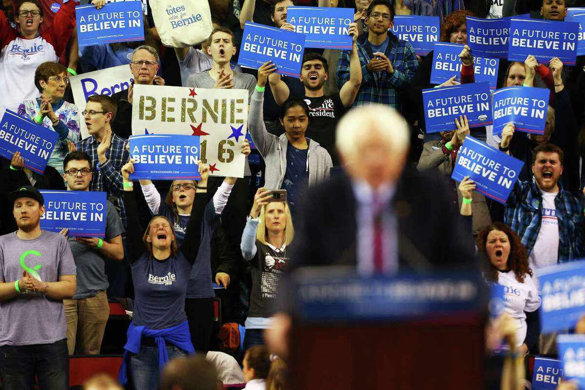 Bernie Sanders speaks to crowds at a rally at Key Arena, Sunday, March 20, 2016.