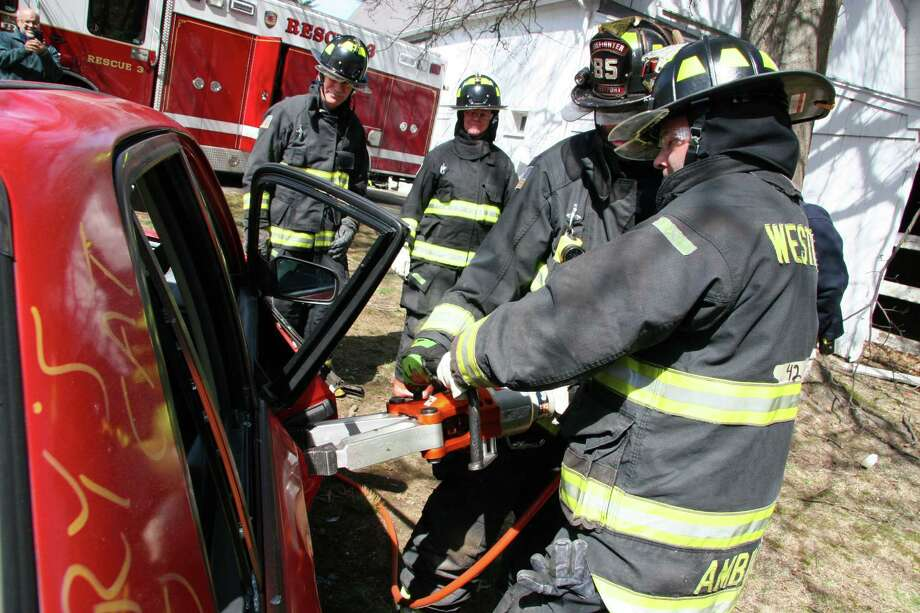 """A vehicle extrication drill was carried out by officials using the jaws of life and other tools duing the """"Fire Ops 101"""" program organized by Westport Uniformed Fire Fighters Association Local 1081. Photo: Contributed / Contributed Photo / Westport News"""