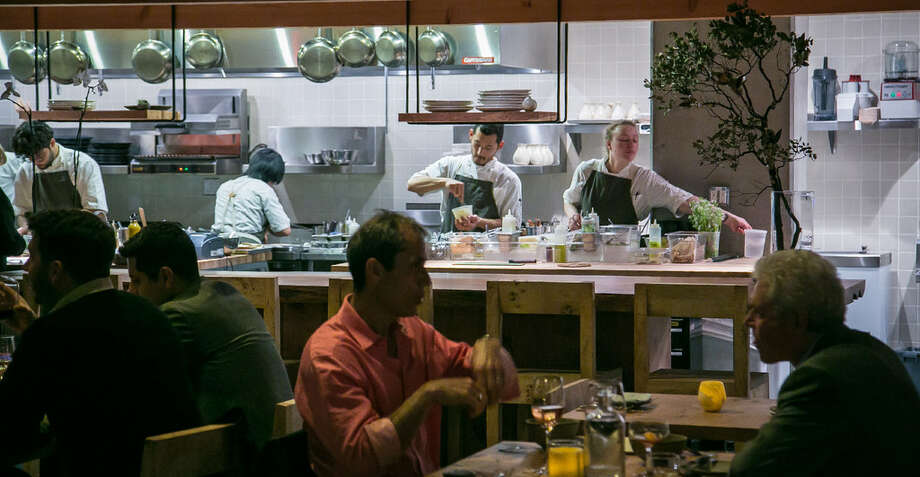 The open kitchen as seen from the dining room at the Perennial. Photo: John Storey/Special To The Chronicle