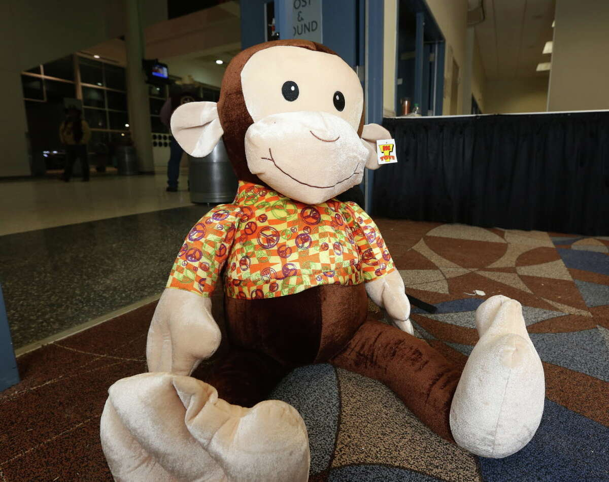A large carnival toy is seen at the lost and found on the last day of the Houston Livestock Show and Rodeo Sunday, March 20, 2016, in Houston.