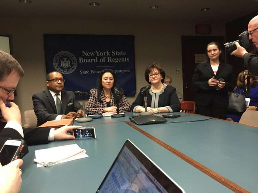 New York state's new education leadership: seated left to right is, Board of Regents Vice Chancellor T. Andrew Brown, Chancellor Betty Rosa, and state Education Commissioner MaryEllen Elia. (Bethany Bump / Times Union)