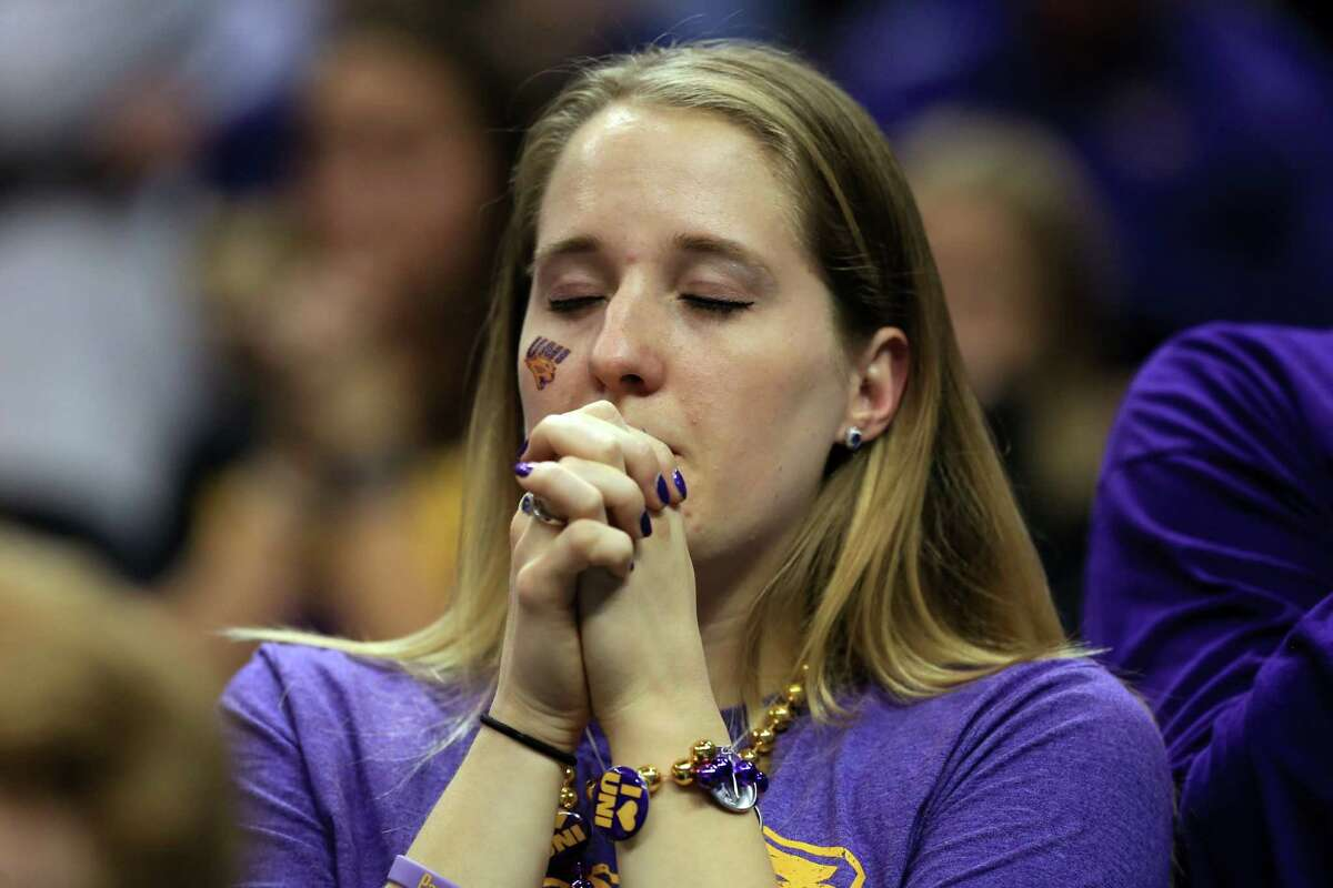 OKLAHOMA CITY, OK - MARCH 20: A Northern Iowa Panthers fan prays in double overtime against the Texas A&M Aggies during the second round of the 2016 NCAA Men's Basketball Tournament at Chesapeake Energy Arena on March 20, 2016 in Oklahoma City, Oklahoma.