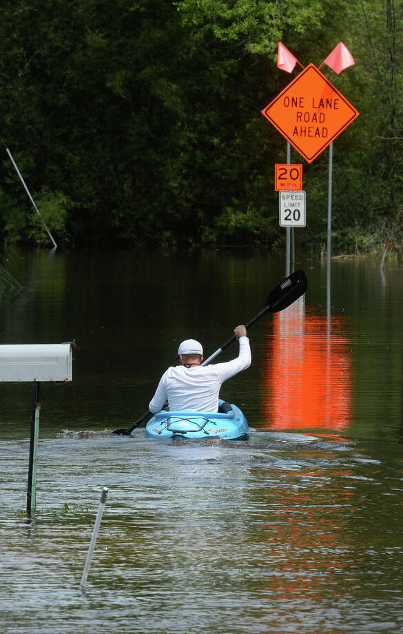 With flood waters blocking the road home, James Young of Orange kayaks to and from his truck each day to leave his house. Photo taken Friday, March 18, 2016 Guiseppe Barranco/The Enterprise Photo: Guiseppe Barranco, Photo Editor