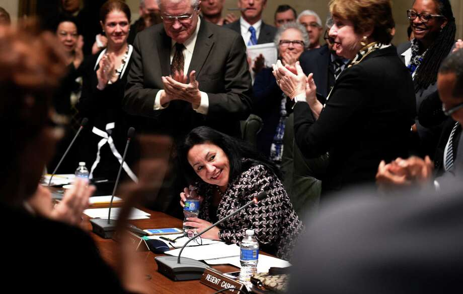 Betty Rosa receives applause from other members of the Board after being named the Chancellor elect of the New York State Board of Regents on Monday morning, March 21, 2016, during a meeting held at the Education Department building in Albany, N.Y. Rosa will take office on April 1st replacing Merryl H. Tisch. (Skip Dickstein/Times Union) Photo: SKIP DICKSTEIN / 10035899A