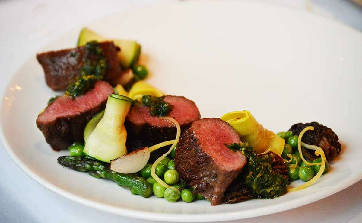 Spring lamb loin with spring peas, mint, preserved Meyer lemon and gremolata from the new spring menu by chef de cuisine Jonathan Wicks at Hotel ZaZa's Monarch Bistro, Houston.
