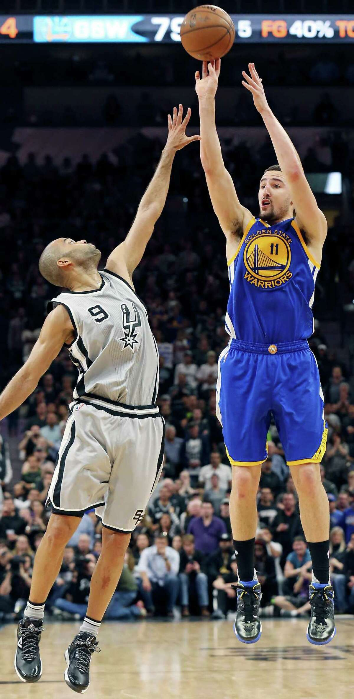 San Antonio Spurs' Tony Parker defends Golden State Warriors' Klay Thompson during second half action Saturday March 19, 2016 at the AT&T Center. The Spurs won 87-79.