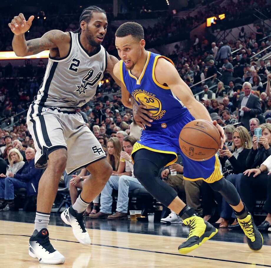 San Antonio Spurs' Kawhi Leonard defends Golden State Warriors' Stephen Curry during second half action Saturday March 19, 2016 at the AT&T Center. The Spurs won 87-79. Photo: Edward A. Ornelas, Staff / San Antonio Express-News / © 2016 San Antonio Express-News