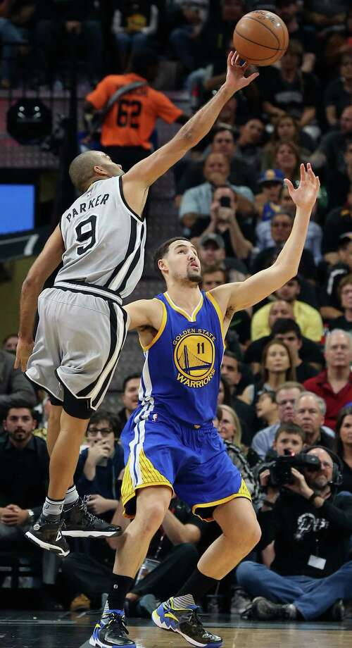 Tony Parker tips away a pass intended for Klay Thompson as the Spurs host the Warriors at the AT&T Center  on March 19, 2016. Photo: TOM REEL, STAFF / SAN ANTONIO EXPRESS-NEWS / 2016 SAN ANTONIO EXPRESS-NEWS