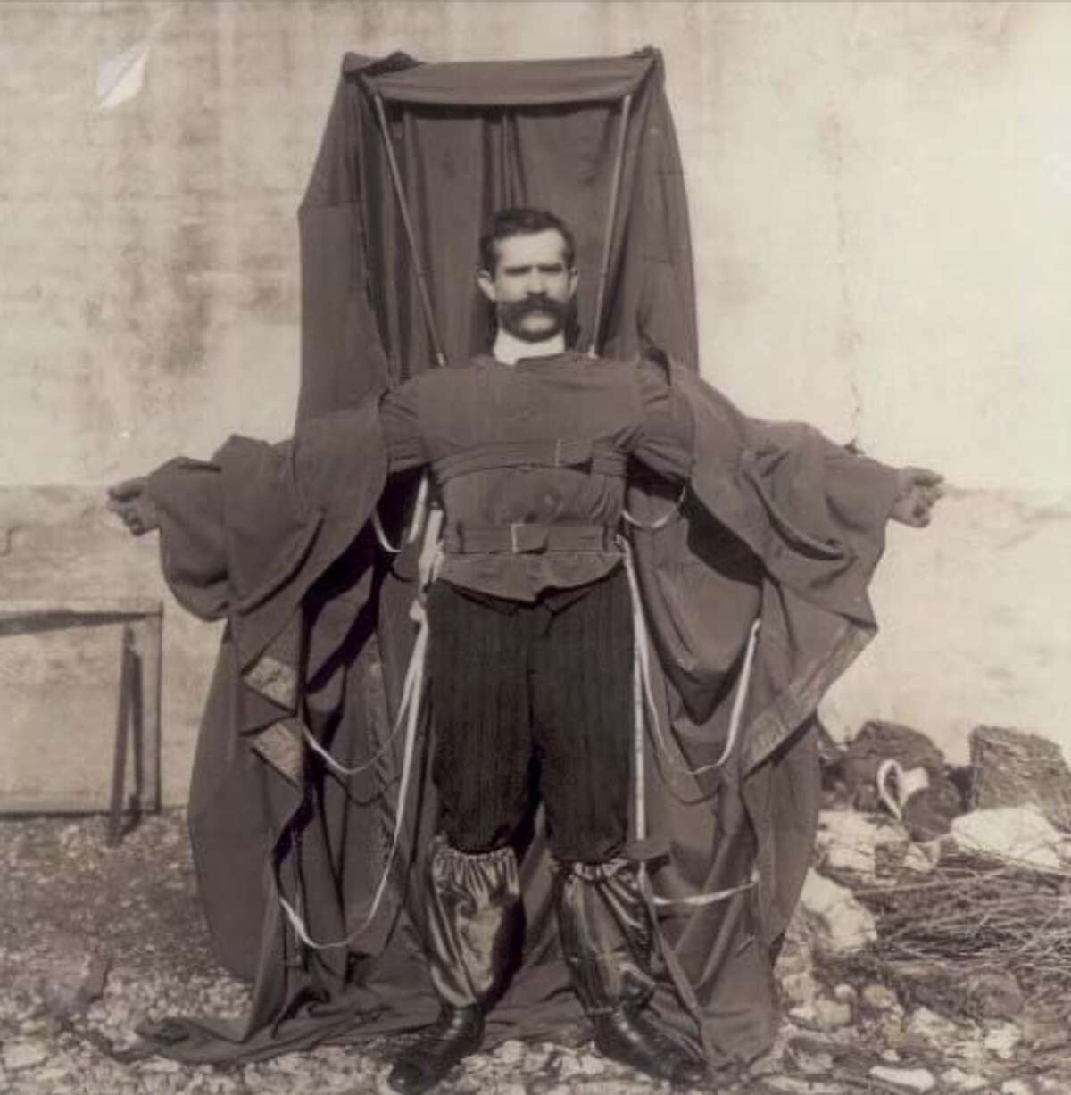 Franz Reichelt (1879-1912), a tailor, fell to his death off the first deck of the Eiffel Tower while testing his invention, the coat parachute. It was his first attempt with the parachute, and he had told the authorities he would first test it with a dummy.