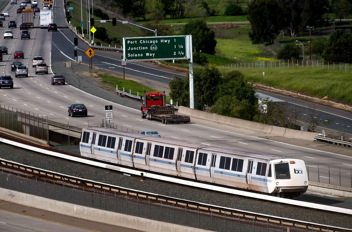 A BART train runs along Highway 4 between the Pittsburg-Bay Point and North Concord stations on Monday, March 21, 2016, in Concord, Calif. The transit agency and its labor unions reached an accord on Nov. 25, 2020 that will likely prevent worker strikes for the next 3 1/2 years.