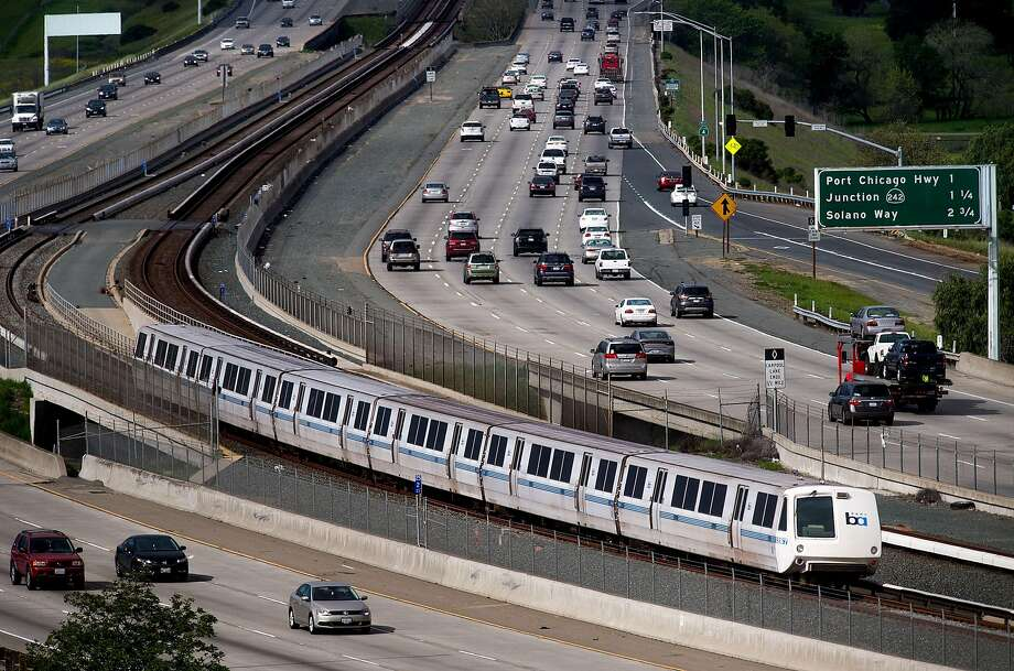 A BART train runs along Highway 4 between the Pittsburg-Bay Point and North Concord stations in this file photo Monday, March 21, 2016, in Concord, Calif.  Photo: NOAH BERGER / SAN FRANCISCO CHRONICLE