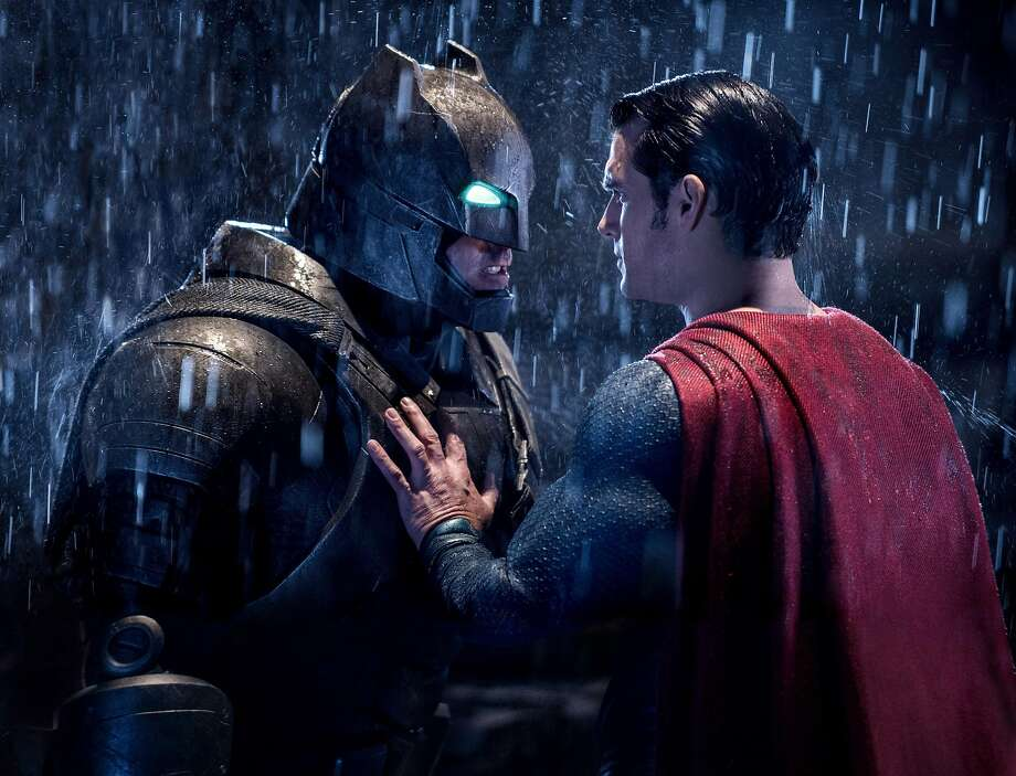 "This image released by Warner Bros. Pictures shows Ben Affleck, left, and Henry Cavill in a scene from, ""Batman v Superman: Dawn of Justice.""KEEP CLICKING FOR MORE OF BATMAN IN FILM OVER THE YEARS.  Photo: Clay Enos, AP"