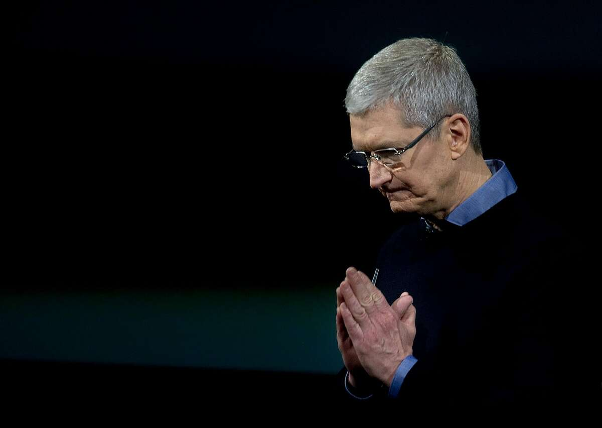 Apple CEO Tim Cook gestures during a media event at Apple headquarters in Cupertino, California on March 21, 2016. Apple on Monday unveiled a new iPhone with a four-inch screen, aiming to reach consumers looking for a handset that is more affordable and compact than its flagship models. / AFP PHOTO / Josh EdelsonJOSH EDELSON/AFP/Getty Images