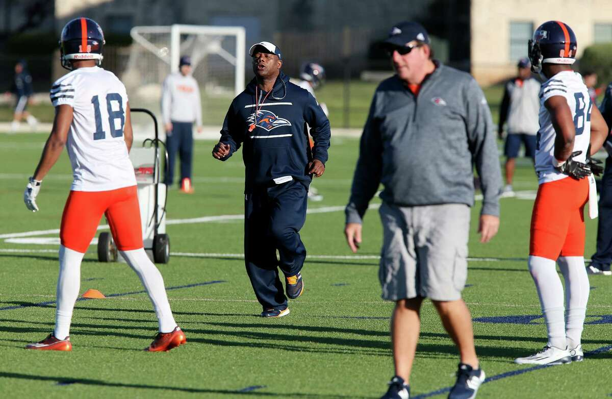 University of Texas at San Antonio head football coach Frank Wilson, center, goes through the first day of Spring Training at the main campus, Monday, March 21, 2016. Wilson was named head coach of the team after the first coach of the program, Larry Coker, resigned in January.