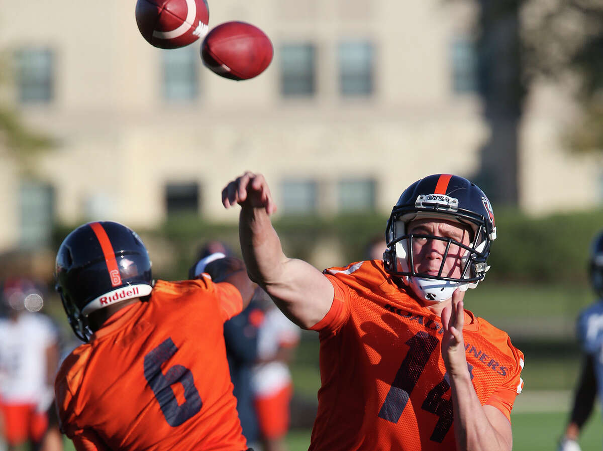 University of Texas at San Antonio quarterbacks Dalton Sturm, right, of Goliad, Texas and Jaylon Henderson, of Kingwood, Texas, go through drills during the first day of Spring Training at the main campus, Monday, March 21, 2016.