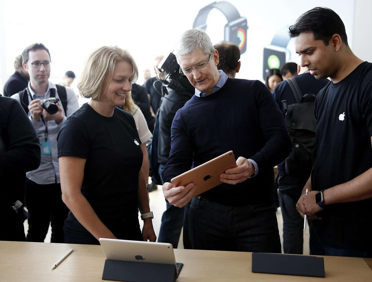 Apple CEO Tim Cook plays with a new iPad Pro during an Apple product launch event at Apple headquarters in Cupertino, California, on Monday, March 21, 2016.