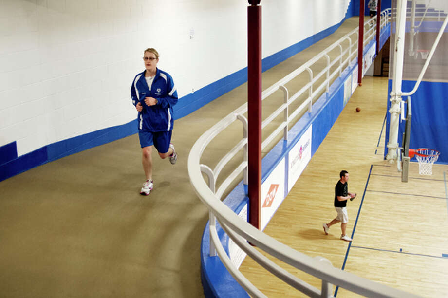 "Elizabeth Gisse of Midland runs laps at the Midland Community Center. She will compete in cross-country skiing in the upcoming 2014 Michigan Special Olympics State Winter Games which will be held in and around Traverse City. Gisse also competes in track and field, basketball, cycling and softball in the summer games. ""I'm very stoked for it,"" Gisse said. ""It's helping keeping people fit."" Photo: Neil Blake/Midland  Daily News / Midland Daily News"