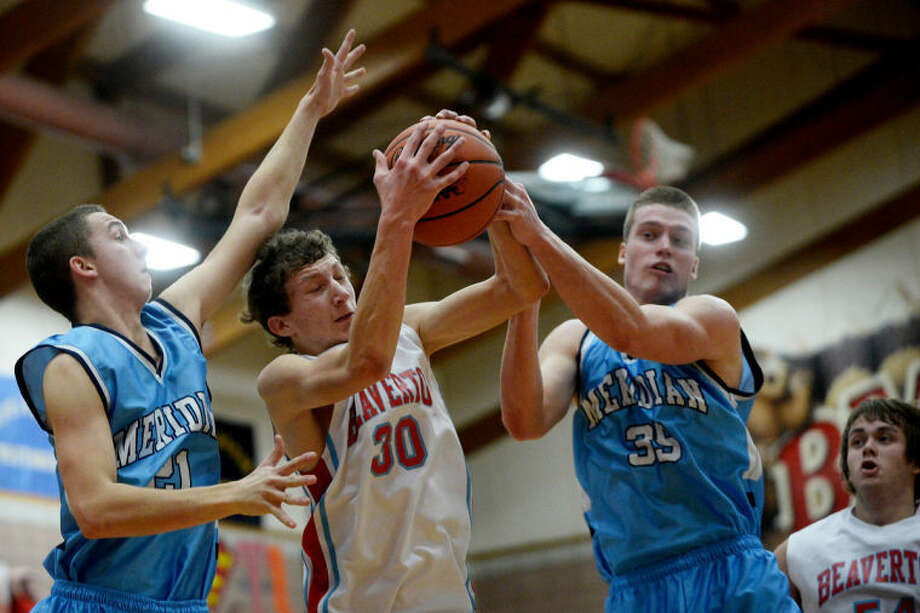 SEAN PROCTOR | sproctor@mdn.netBeaverton's Ryan Duvall grabs a rebound against Meridian's Mitch Kucharek, right, Wednesday during their game at Beaverton High School. Meridian defeated Beaverton 30-29. Photo: Sean Proctor/Midland  Daily News