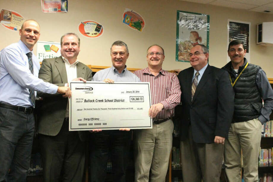 Orrin Shawl | for the Daily NewsConsumers Energy presents a rebate check worth $126,360 to Bullock Creek School District Monday night. From left to right are Marc Coburn, Thomas Shirilla, Tom Begin, Jim Nemeth, Charlie Schwedler and Bill Rogers.