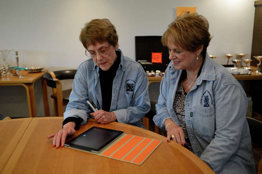 Judy Campbell, left, and Jere Hunt research an item online. Photo: Neil Blake