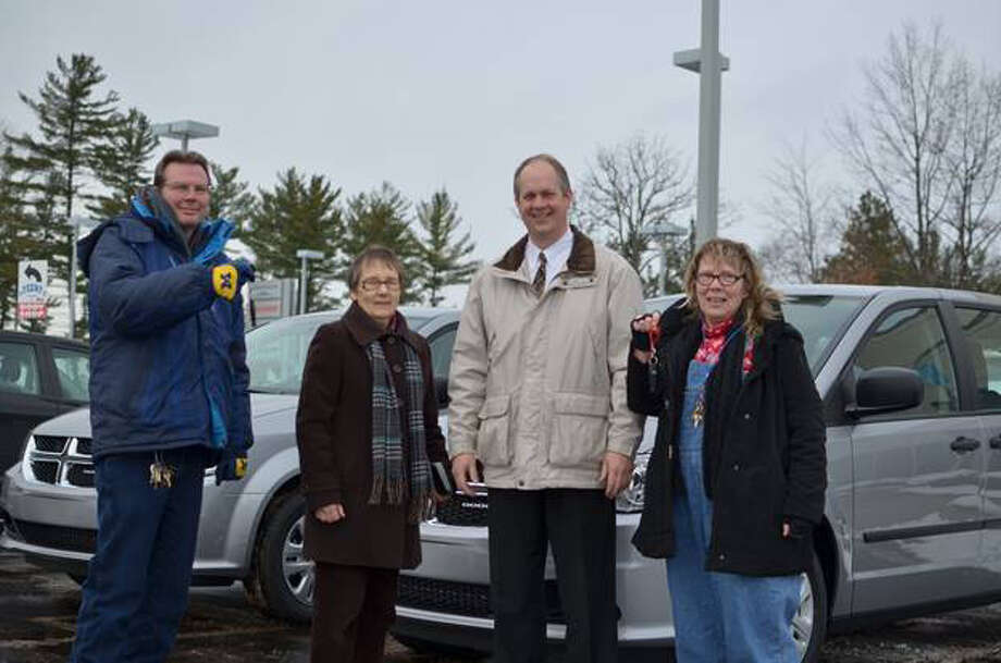 Photo providedMidland's Open Door staff, Ken Hicks, Sue LaBean and Becky Fenimore, receive vehicle keys from sales managerStacey Cowan at Feeny Chrysler Jeep Dodge of Midland.